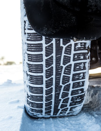 winter tire: Winter tire on a cold winter day. Stock Photo