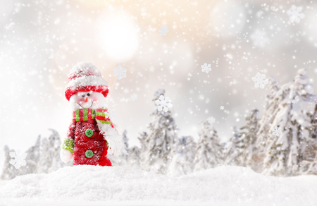 snow background: Christmas background with snowman and falling snow.