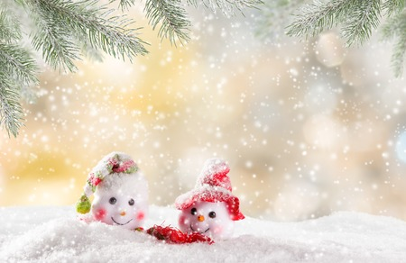 stars sky: Christmas background with snowmen and falling snow.