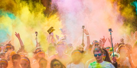 colored powder: Close-up of color marathon, people covered with colored powder.