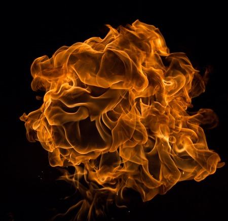 Fire flames on black background, close-up. Reklamní fotografie