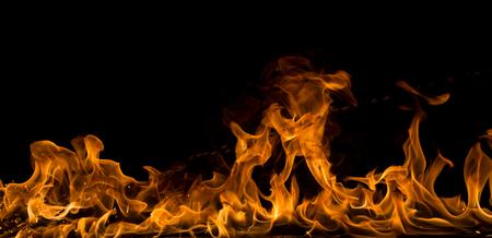 Fire flames on black background, close-up. Foto de archivo