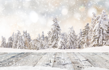 fine wood: Abstract Christmas background with falling snow flakes and wooden table