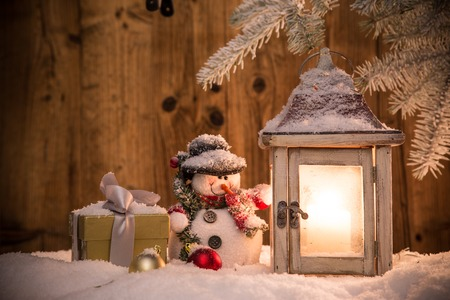 frosty: Christmas background with lantern and falling snow. Stock Photo