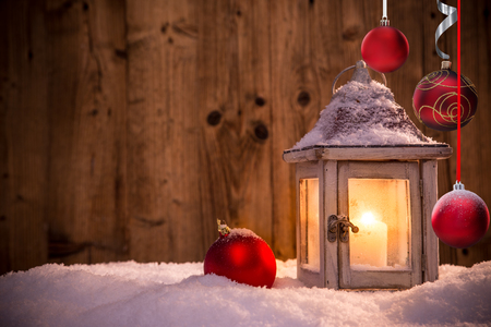 Christmas background with lantern and falling snow. Stock Photo