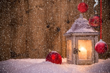 celebrate: Christmas background with lantern and falling snow. Stock Photo