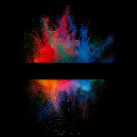 a smoke: Launched colorful powder, isolated on black background