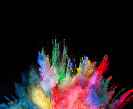 abstract smoke: Launched colorful powder, isolated on black background
