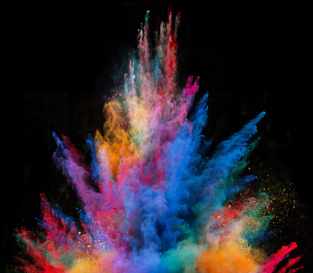 Launched colorful powder, isolated on black background