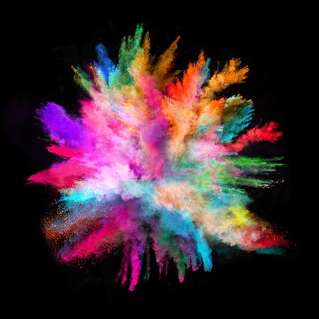 colorido: Lanzado en polvo colorido, aislado en el fondo negro Foto de archivo