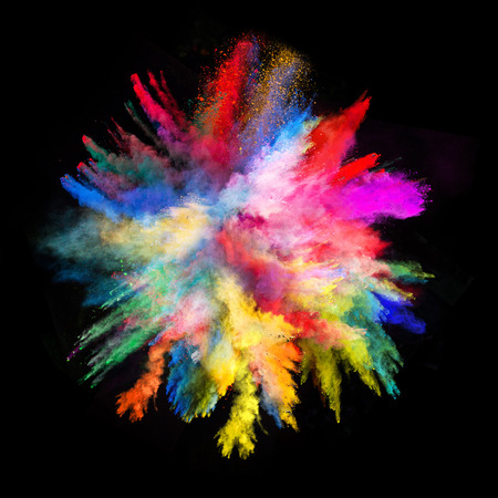 color: Launched colorful powder, isolated on black background