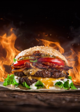 barbecue fire: Close-up of home made burger with fire flames