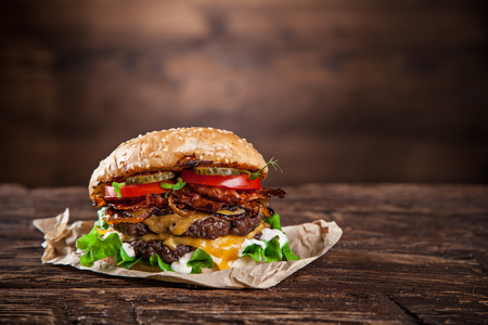 Close-up of home made burger on wooden background Stock Photo