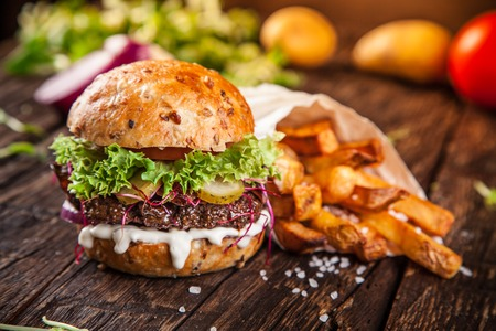 Close-up of home made burger on wooden background Stok Fotoğraf