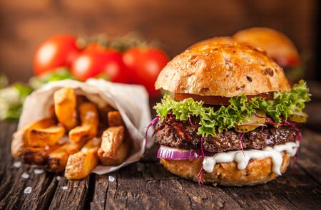 Close-up of home made burgers on wooden background Stock Photo - 47419453
