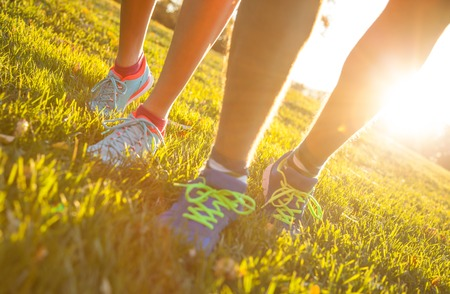 outdoor: Runner legs outside during autumn day, close-up. Stock Photo