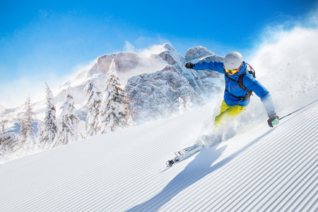 snow ski: Skier skiing downhill in high mountains
