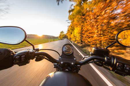a motorcycle: The view over the handlebars of a speeding motorcycle