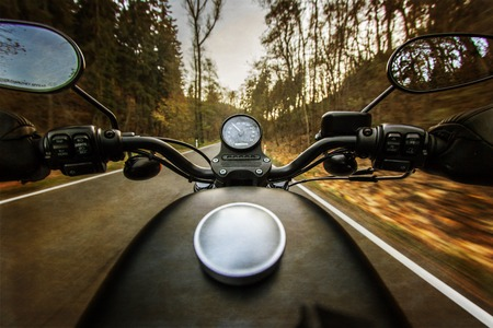 MOTORCYCLES: The view over the handlebars of a speeding motorcycle