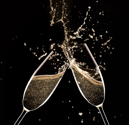 congratulations: Glasses of champagne with splash, isolated on black Stock Photo