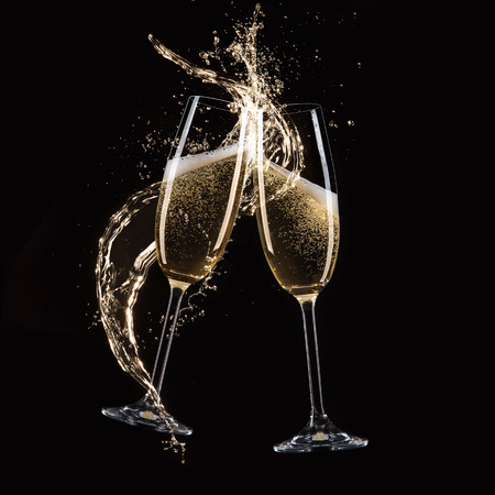 Glasses of champagne with splash, celebration theme. Stok Fotoğraf
