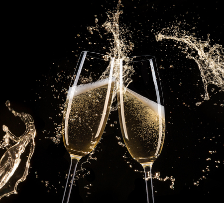 bubbly: Glasses of champagne with splash, isolated on black Stock Photo