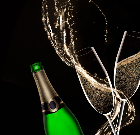 champagne: Glasses of champagne with splash, isolated on black Stock Photo