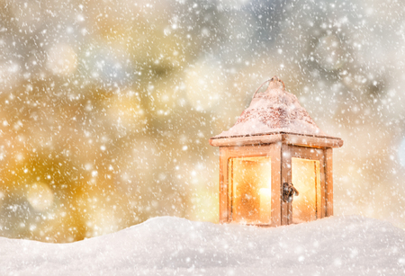 Abstract Christmas background with lantern and falling snow flakes