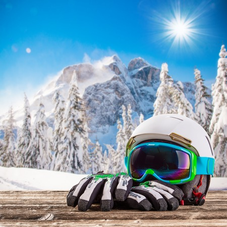 ski mask: Colorful ski glasses on snow. Winter ski theme.