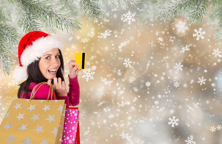 shoppingbag: Christmas Shopping. Happy young girl with shopping bags. Winter theme.