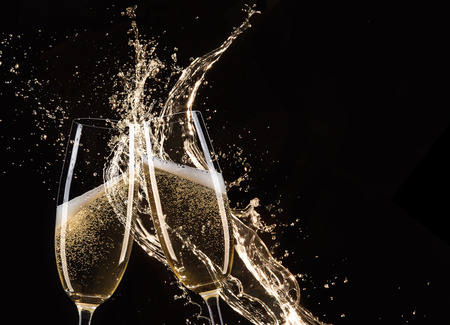 champagne glasses: Glasses of champagne with splash, isolated on black Stock Photo