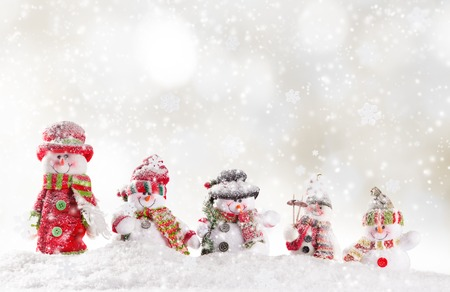 christmas stars: Christmas background with snowmen and falling snow.