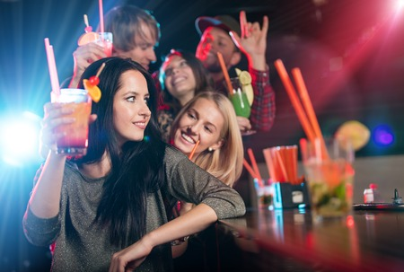 nightclub crowd: Group of young people having fun in club, celebration theme.
