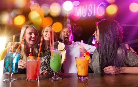 cocktail bar: Group of young people having fun in club, celebration theme.