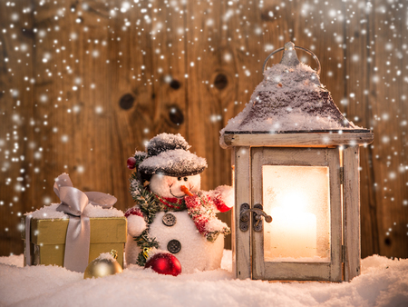 christmas winter: Abstract Christmas background with shining lantern and falling snow flakes