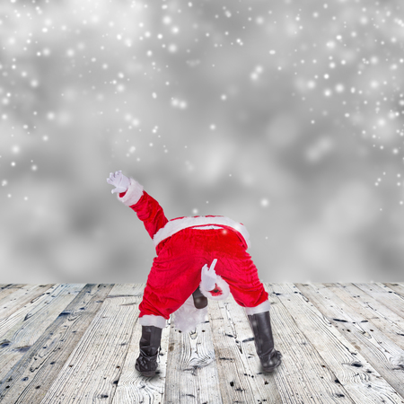 Santa Claus with upraise middlefingers, concept of Christmas hatred. Stock Photo