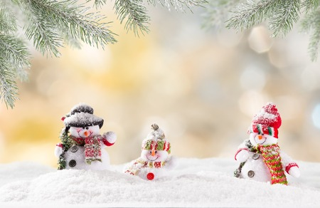 Christmas background with snowman and falling snow.