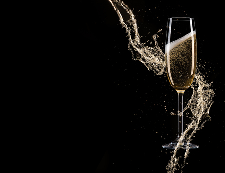 Glasses of champagne with splash, isolated on black Фото со стока