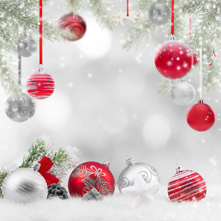 xmas background: Decorative christmas background with balls and snow, close-up. Stock Photo
