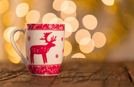 stilllife: Christmas background with cup of tea on wooden table. Stock Photo