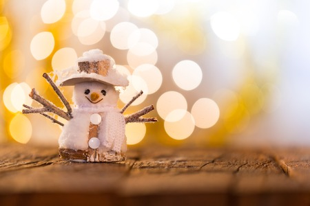 stilllife: Christmas background with snowman on wooden table.