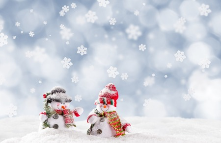 winter background: Christmas background with snowman and falling snow.