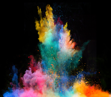 white powder: Launched colorful powder, isolated on black background