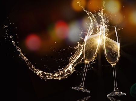 Glasses of champagne with splash, isolated on black Stok Fotoğraf