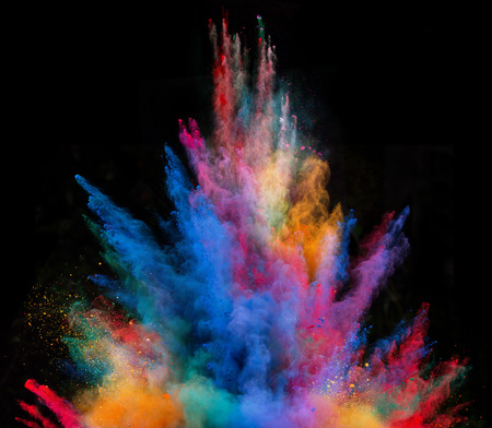 Explosion of colorful powder, isolated on black background Imagens