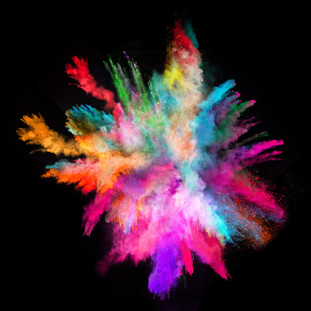 color: Explosion of colorful powder, isolated on black background Stock Photo