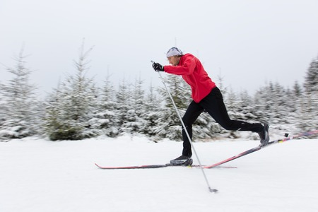 crosscountry: Young man cross-country skiing. Winter sport.