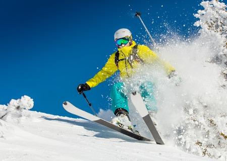 extreme sports: Freeride in fresh powder snow. Skiing.