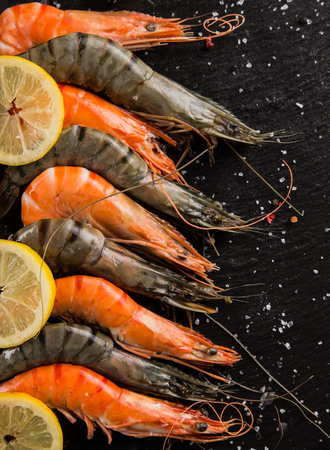 drifting ice: Cooked prawns served on black stone