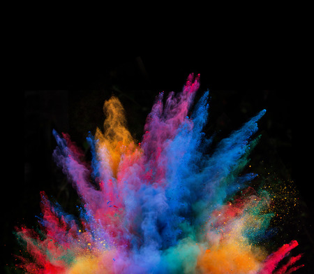 splatter paint: Explosion of colorful powder, isolated on black background Stock Photo